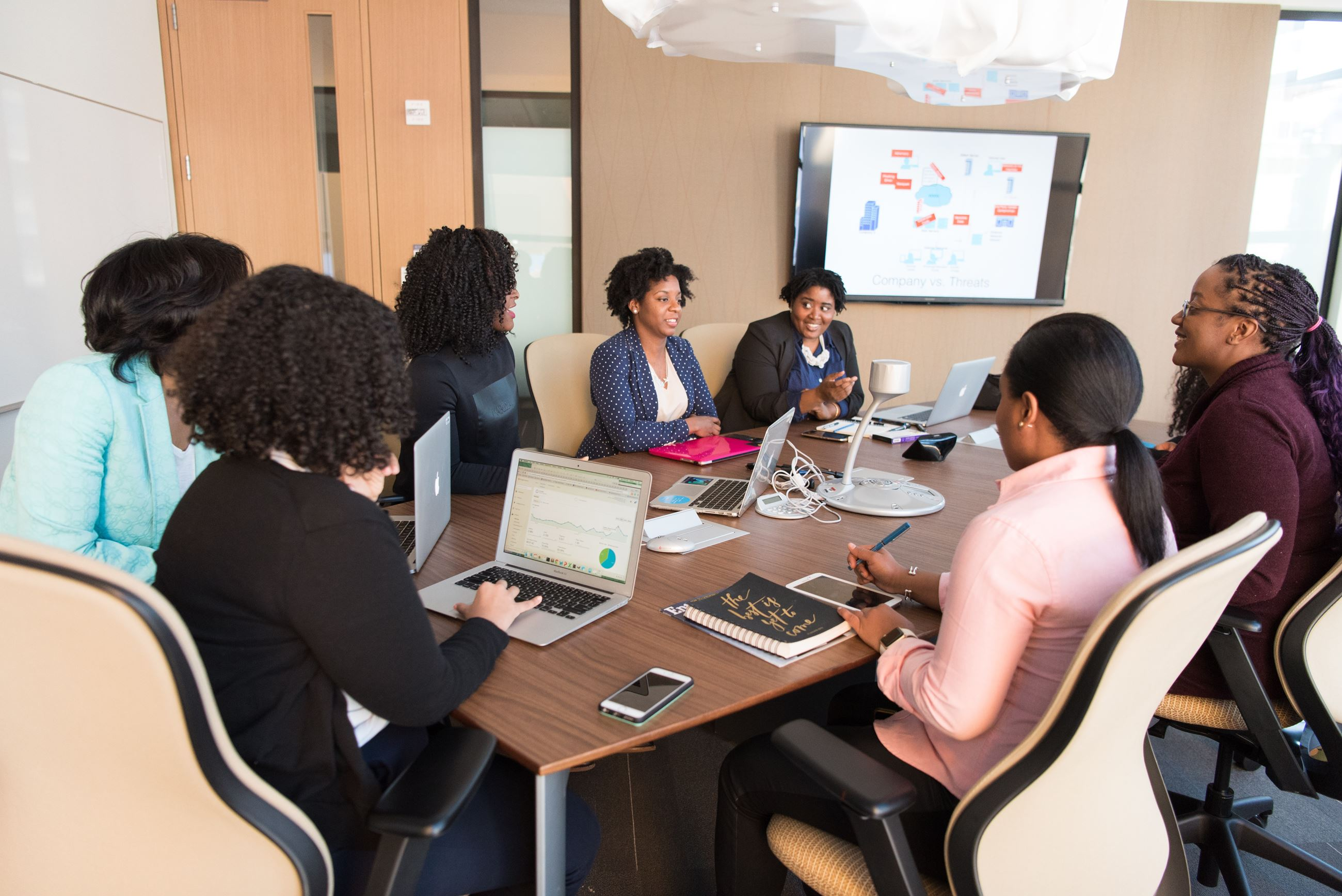 image of a group of women brainstorming at a meeting